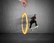 Businessman skating on money skateboard through fire circle