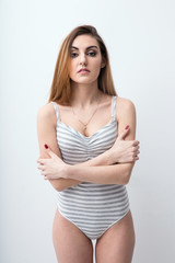Portrait of a sexy woman with arms folded