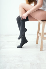 Closeup image of a woman dressing gaiters