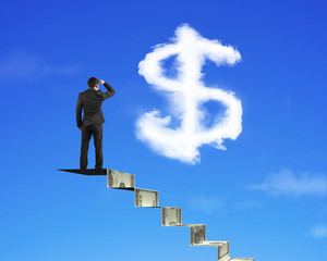 Businessman on money stairs looking at dollar sign shape cloud