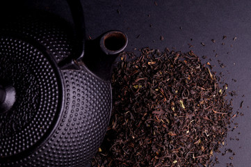Black Teapot with Healthy Tea Leaves