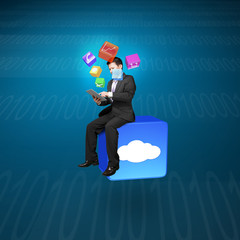 Businessman using tablet sitting on cloud app icon with tech