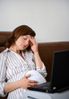 Tired working pregnant woman