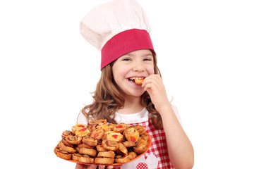 hungry little girl cook eating bruschette