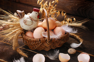 easter decoration of hen in wicker basket with eggs