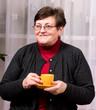 Mature woman enjoying cup of coffee