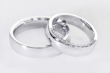 Two wedding rings isolated on white