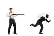 Angry guy with rifle shooting at a burglar