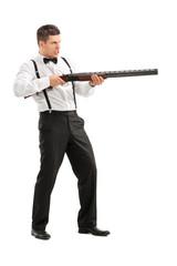 Angry young man shooting at something