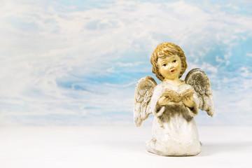 Himmlischer Engel mit Buch als Hintergrund; Taufe, Kommunion