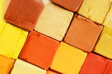 Creative art background - closeup of bright pastel crayons