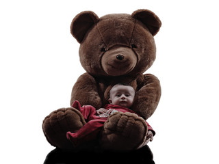 teddy bear hugging baby sitting silhouette