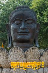 buddha head lotus flower Wat Thammikarat temple Ayutthaya bangko