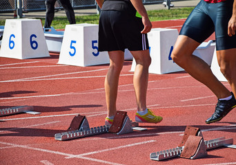 Runners at the starting line of the running track