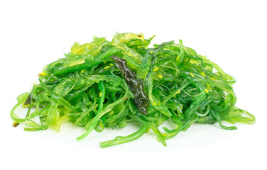 A portion of fresh wakame seaweed on a white background