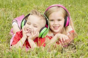 girl with a boy in headphones listening to music