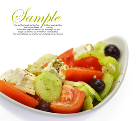 Bowl with fresh Greek Salad isolated on white background