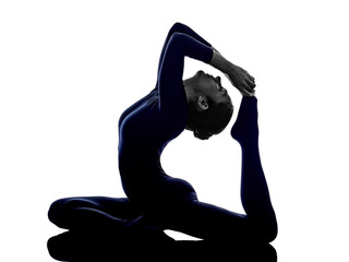 woman exercising Eka Pada Rajakapotasana One Legged King Pigeon