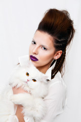 Beautiful woman holding white persian cat