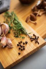 Closeup on pepper garlic and rosmarinus on cutting board