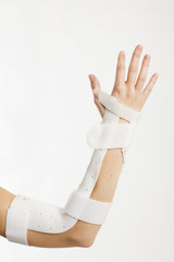 broken arm with brace. Caucasian. White background