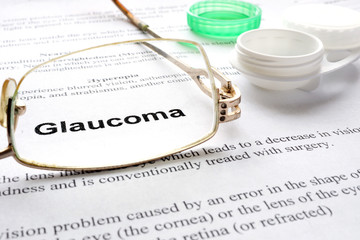Paper with words  glaucoma, glases and container for lenses.