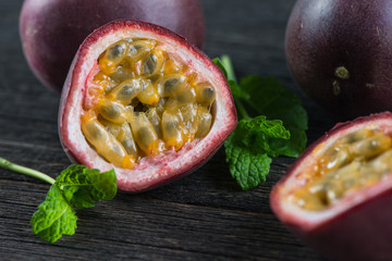 Fresh whle and cut passion fruits on wooden background