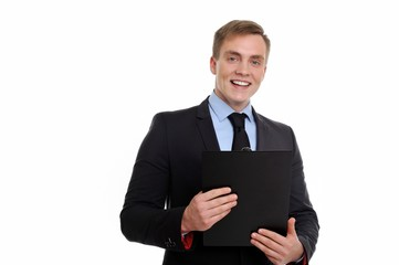 Portrait of a smiling businessman holding clipboard.