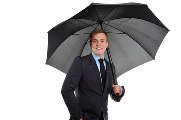 Attractive smiling young businessman with umbrella.