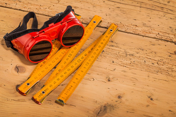 red safety goggles  and measure tool