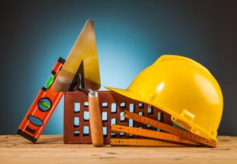 yellow helmet and builder tools