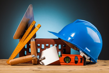 blue helmet and builder tools