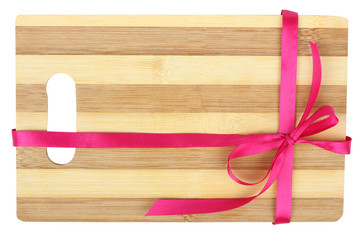 wooden cutting board with a ribbon on a white background