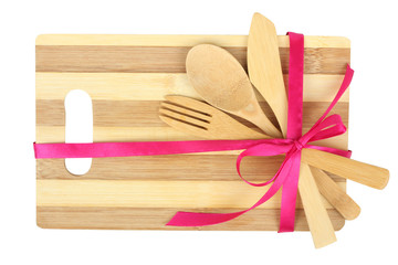 Cooking background - cutlery on cutting board tied with ribbon