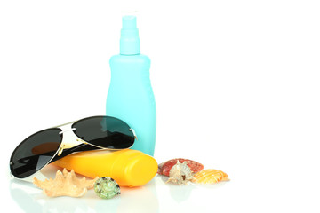Sunglasses and sunscreen isolated on white