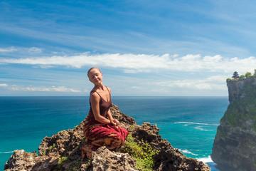 Happy tourist near Uluwatu