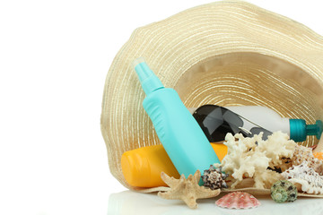 suntan cream, sunglasses and hat isolated on white