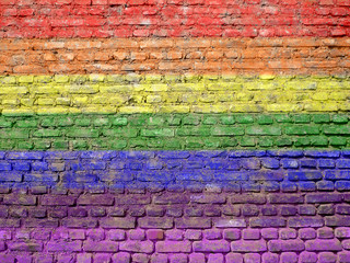 Rainbow-flag painted on old wall