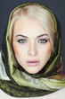 Beautiful blond woman in scarf.Beauty Girl.green cat eyes