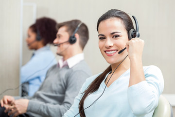 Smiling Female Customer Service Executive Working In Office