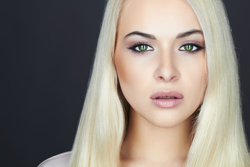 Young Beautiful blond woman.Beauty Girl.green cat eyes.make-up