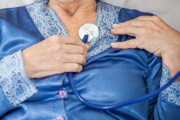 Senior Woman Examine Herself With Stethoscope