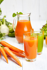 carrot juice on white wood  background
