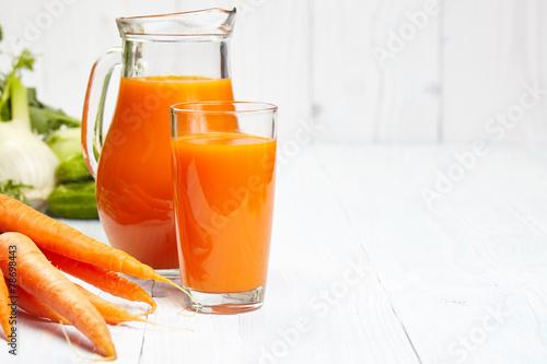 carrot juice on white wood  background - 78698443