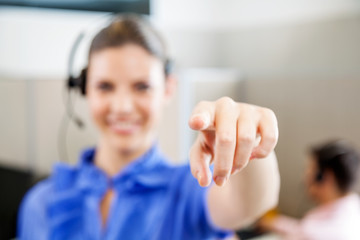 Customer Service Representative Pointing In Office
