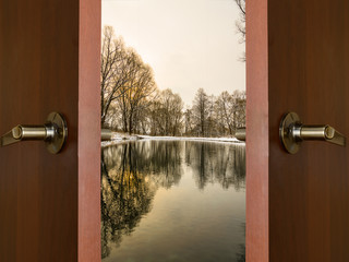 open door and a winter forest