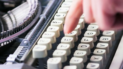 typewriter typing. Vintage typewriter being used by male hands