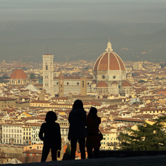 profiles of tourists admiring fantastic view of Florence city se