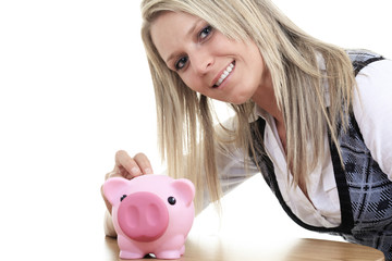 Business woman saving in a piggybank - isolated over a white