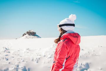 Woman explorer skier looking the snowy horizon